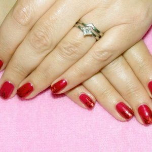 Shellac in Red Baroness with holographic red foil fade.