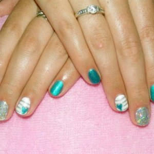 Shellac in Hotski to Tshotchke with holo silver glitter and feature nails in Cream Puff with stripes and heart.