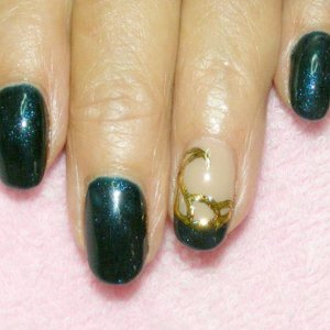 Shellac in Midnight Swim with gold foil casting on feature nail