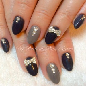 Swarovski Crystals and diamonte bows on my own nails