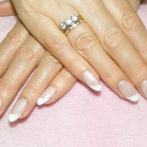 """Alternative French Shellac with """"VIP Silver Status"""" shimmer and Swarovski crystals on her feature nails."""