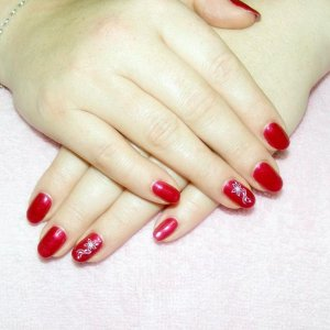 """Shellac in """"Red Baroness"""" with stamping on feature nails."""