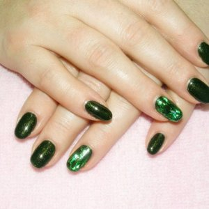 """Shellac in """"Pretty Poison"""" with 3d green holographic foil feature nails"""