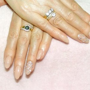 Shellac in Nude Knickers with feature nails in raised netting effect with Swarovski crystals.