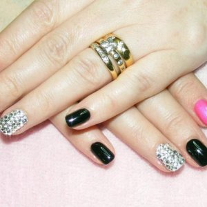 Shellac in Blackpool and Tutti Frutti with feature nail of Swarovski crystals.