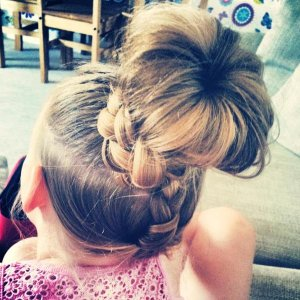 this is my god daughters hair she was going to a bbq and her mum wanted her hair up as her hair goes to her bum :) it was a little difficult cause she 4 and wont sit still but i think it good practice