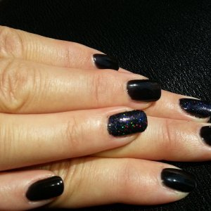 Black onyx gellux with holographic glitter ring finger