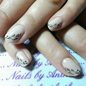 Ivory beige with deacals and foil dot nail art