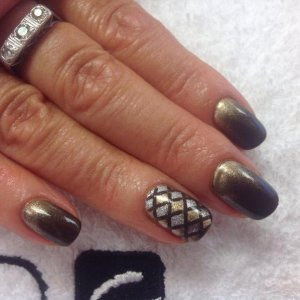 shellac on a natural nail with additives and lecente star dust accents