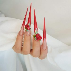 Red stiletto nails with 3d nail art