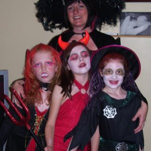 My sister and her three ghastly ghouls (only one is actually hers).  She just needed to go and get changed, lol!