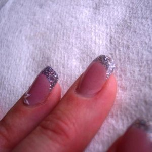 Black glitter+transparent powder at free edge, translucent pink on the rest of the nail.